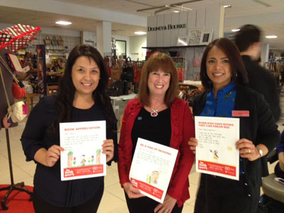 Wake-up rally with Macy's associates, Yesenia and Marie, store managers, to cheer on everyone to sell coupons for RIF. The more coupons, the more books equals happy kids reading!