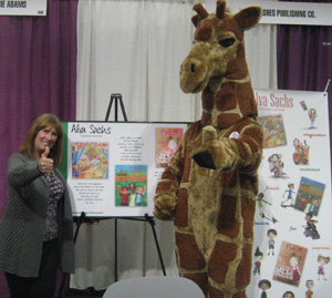 Giraffe, the 2012 Girl Scout cookie mascot, and Alva share a moment together